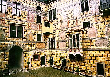 Mural on IV. courtyard of Český Krumlov Castle, details of figural decoration above oriel
