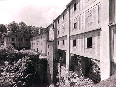 Connecting corridor - section leading from Renaissance House and Castle Theatre on the 5th courtyard of Český Krumlov Castle in two floors above the Cloak Bridge, historical photo